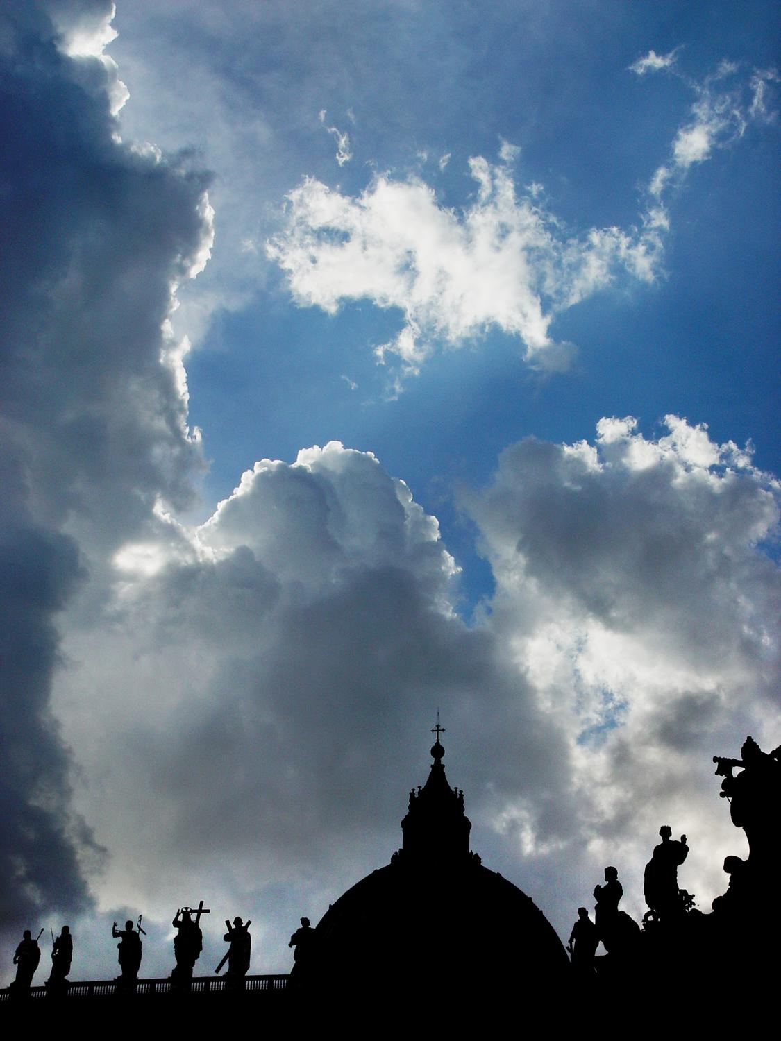 Saints beneath the clouds - dramatic clouds and sun behind the saints atop  Saint Peter's basilica in Rome - Saints beneath the clouds - Techno-Impressionist Museum - Techno-Impressionism - art - beautiful - photo photography picture - by Tony Karp